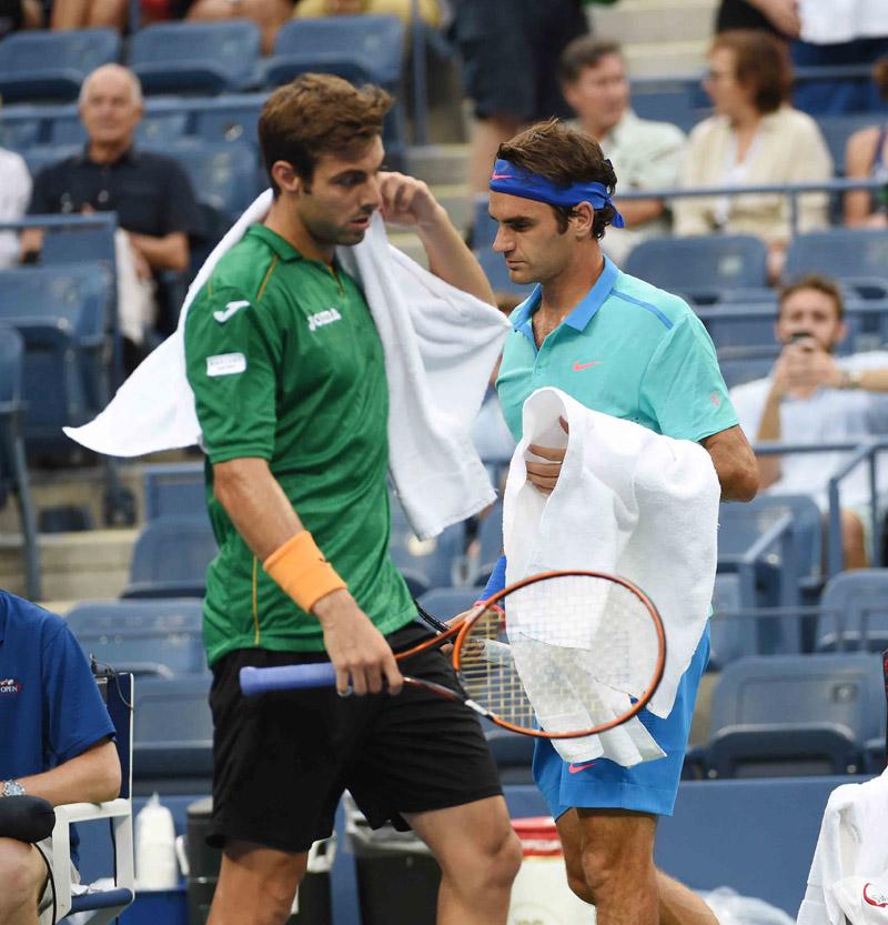 Granollers y Federer US Open 2014 01 b