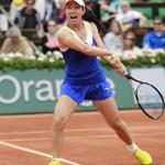 Zheng jugando en Roland Garros 2013